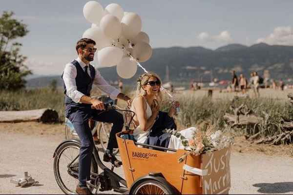 couple making their exit on a bicycle