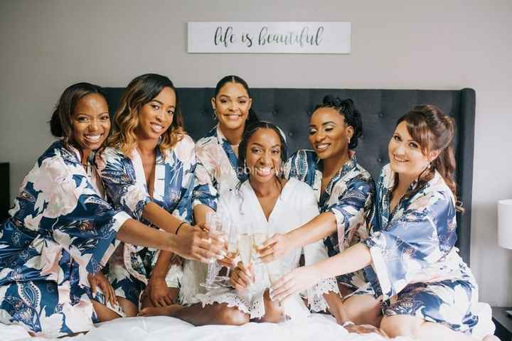 bride and her bridesmaids sitting on bed toasting, silk bridesmaids patterned robes