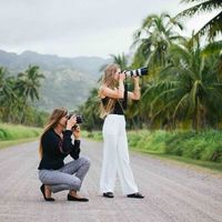 two photographers on a wedding day