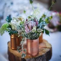 copper cans with flowers, rustic wedding centrepiece