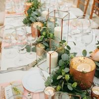 copper wedding centrepiece with candles and greenery