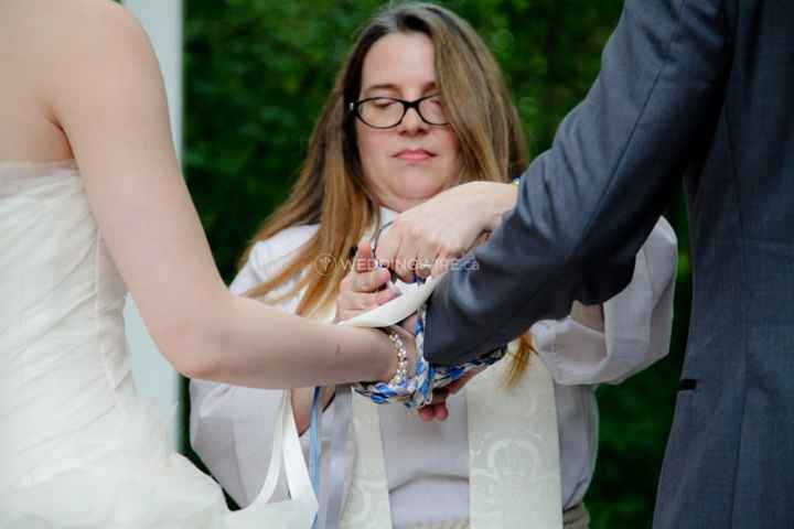officiant performing a handfasting ceremony