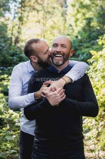 sweet same sex gay couple engagement hug
