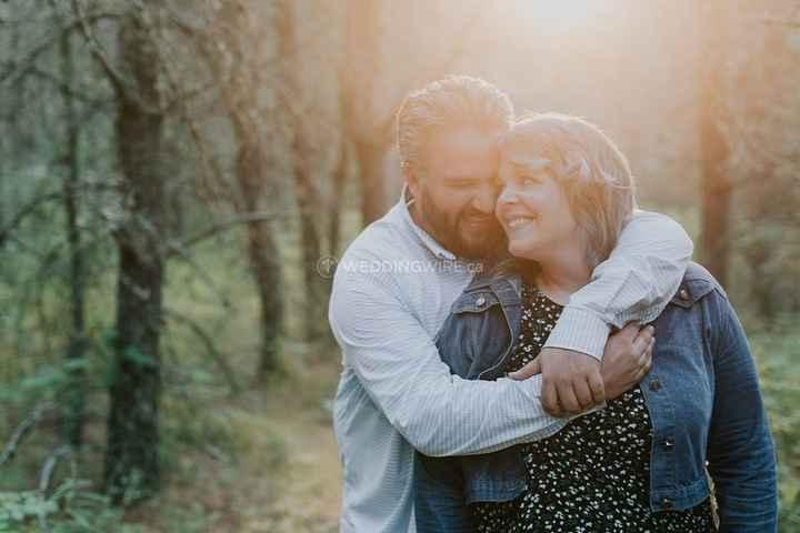 engagement couple outdoors hug lense flare